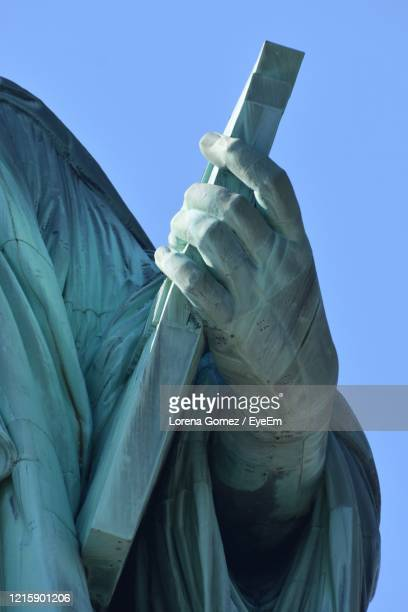 low angle view of statue against clear blue sky - lorena day stock pictures, royalty-free photos & images