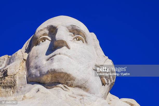 low angle view of statue against clear blue sky - george washington stock pictures, royalty-free photos & images