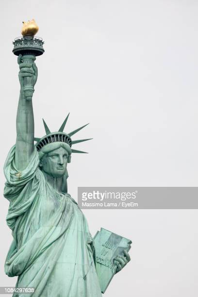 low angle view of statue against clear sky - statue of liberty stock pictures, royalty-free photos & images