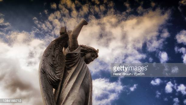 low angle view of statue against sky - male likeness stock pictures, royalty-free photos & images
