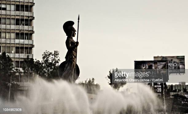 low angle view of statue amidst fountain against sky in city - guadalajara mexico stock pictures, royalty-free photos & images