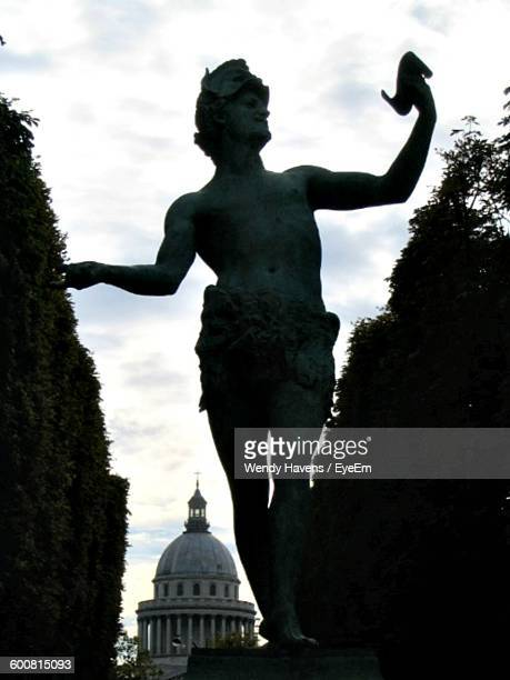 Low Angle View Of Statue At Jardin Du Luxembourg Against Pantheon