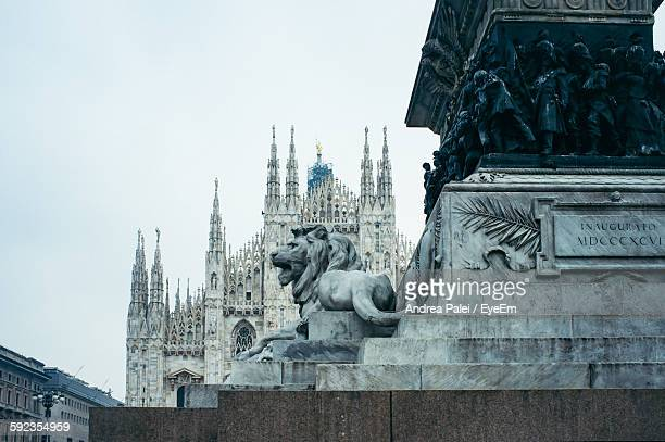 Low Angle View Of Statue At Milan Cathedral Against Sky