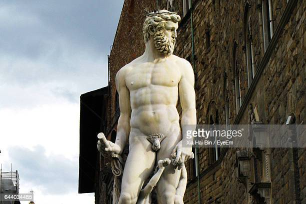 low angle view of statue at piazza della signoria - male likeness stock pictures, royalty-free photos & images
