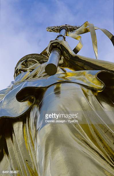 Low Angle View Of Statue At Victory Column Against Sky In City