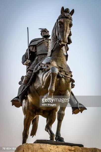 Low angle view of statue of Gjergj Kastrioti, known as Skanderberg on horseback on the main square in Tirana, Albania.