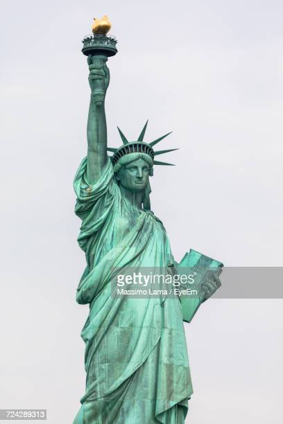 low angle view of statue of liberty - statue of liberty stock pictures, royalty-free photos & images