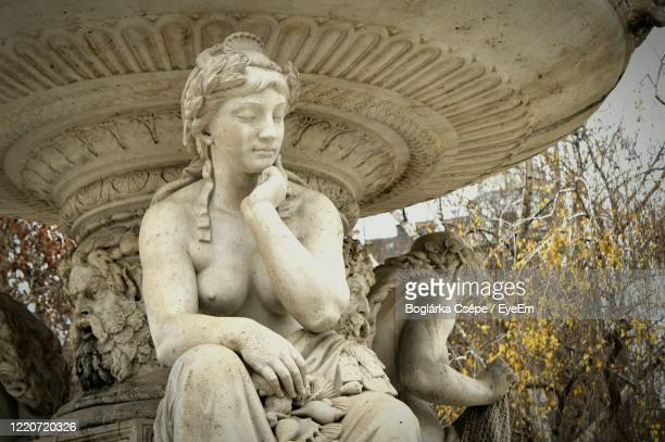 low angle view of statue - female likeness stock pictures, royalty-free photos & images