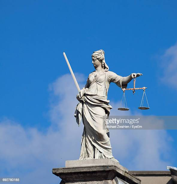 low angle view of statue - lady justice stock pictures, royalty-free photos & images