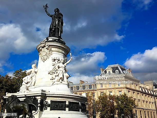 low angle view of statues at place de la republique - place de la republique paris stock photos and pictures