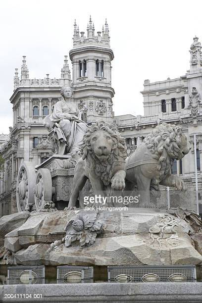 Low angle view of statues of lions on a pedestal