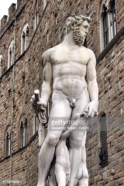 low angle view of statues - male likeness stock pictures, royalty-free photos & images