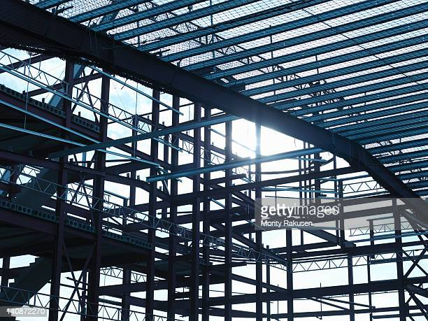 low angle view of steel construction frame on building site - 建物の骨組み ストックフォトと画像
