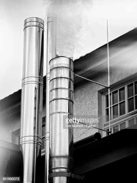 Low Angle View Of Steel Smoke Stacks