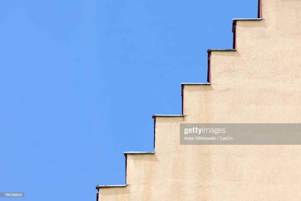 Low Angle View Of Steps Against Clear Blue Sky During Sunny Day : Stock Photo