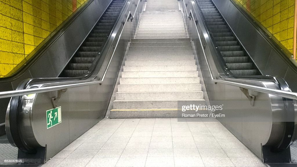 Low Angle View Of Steps Amidst Escalators In Subway : Stock Photo