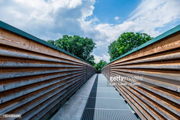 low angle view of steps amidst plants against sky - sankt poelten stock pictures, royalty-free photos & images