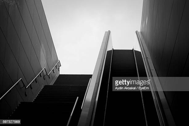Low Angle View Of Steps And Escalator Against Clear Sky