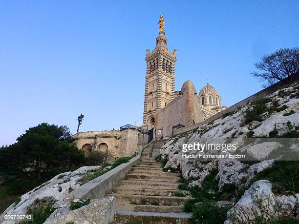 low angle view of steps leading towards notre-dame de la garde against clear sky - ポン・デュ・ガール ストックフォトと画像