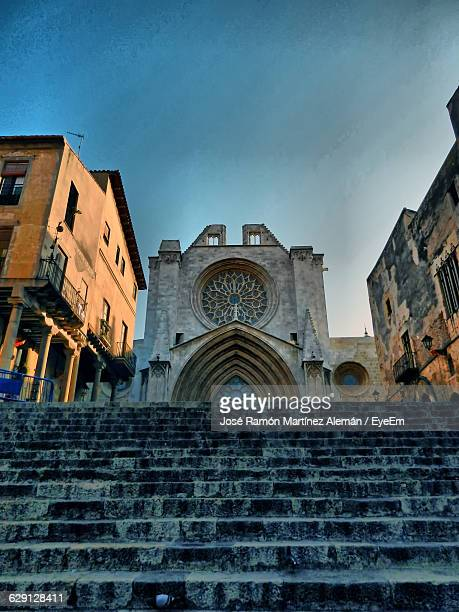 low angle view of steps leading towards tarragona cathedral - tarragona stock photos and pictures