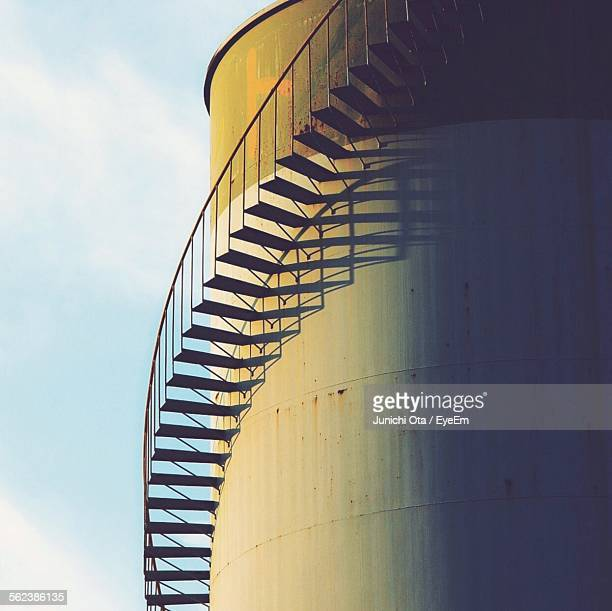 Low Angle View Of Steps On Silo Against Sky