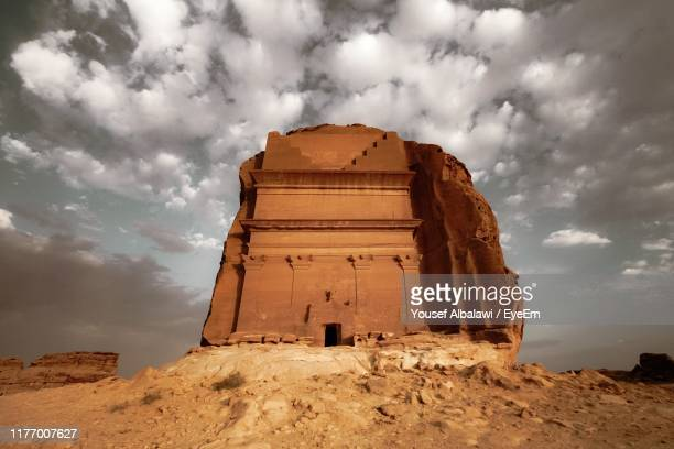 low angle view of stone structure against cloudy sky - old ruin stock pictures, royalty-free photos & images