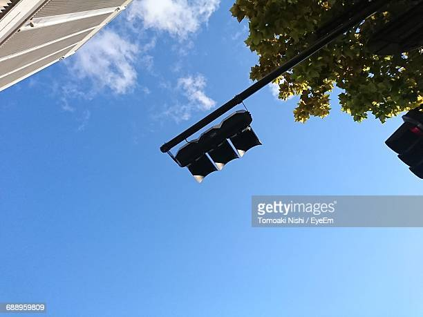 low angle view of stop light against clear sky - road signal stock pictures, royalty-free photos & images