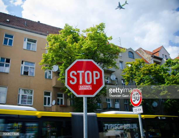Low Angle View Of Stop Sign Against Building In City