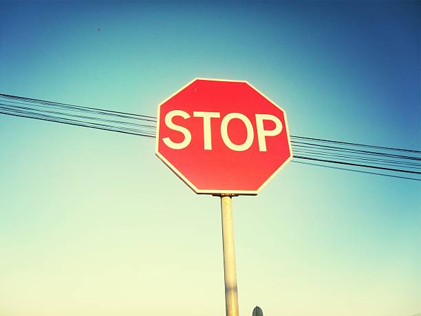 Low Angle View Of Stop Sign Wall Art