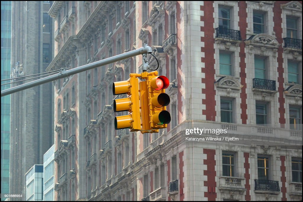 Low Angle View Of Stoplight Against Building : Stock Photo