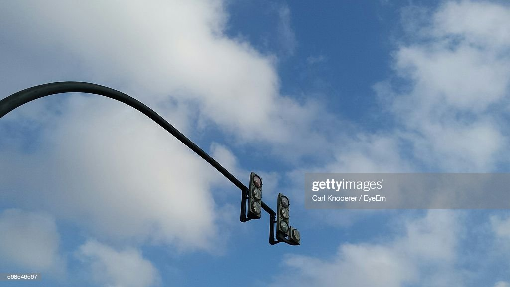 Low Angle View Of Stoplight Against Sky : Stock Photo