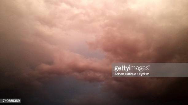 low angle view of storm clouds in sky - land vehicle stock pictures, royalty-free photos & images