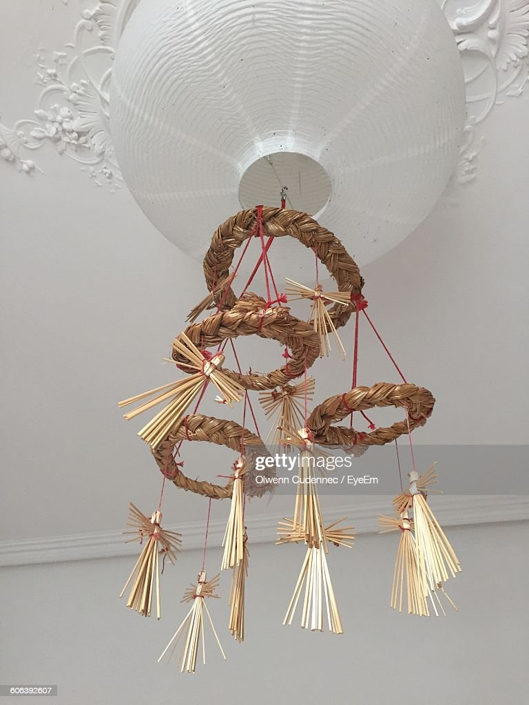 Low Angle View Of Straw Decoration On Lantern Hanging From Ceiling ... for Straw Lantern  104xkb