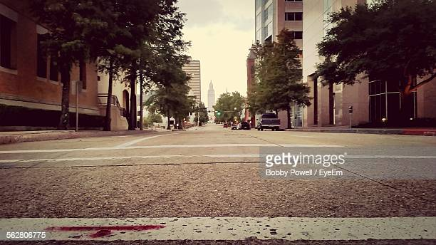 low angle view of street amidst buildings in city - low angle view stock pictures, royalty-free photos & images