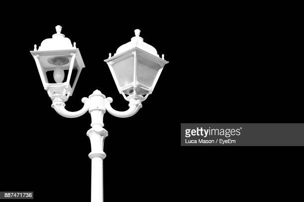 Low Angle View Of Street Light Against Black Background