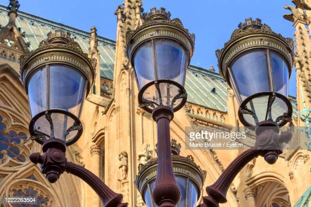 low angle view of street light against building - moselle stockfoto's en -beelden