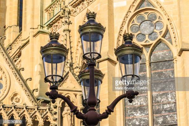 low angle view of street light against building - lorraine stock pictures, royalty-free photos & images