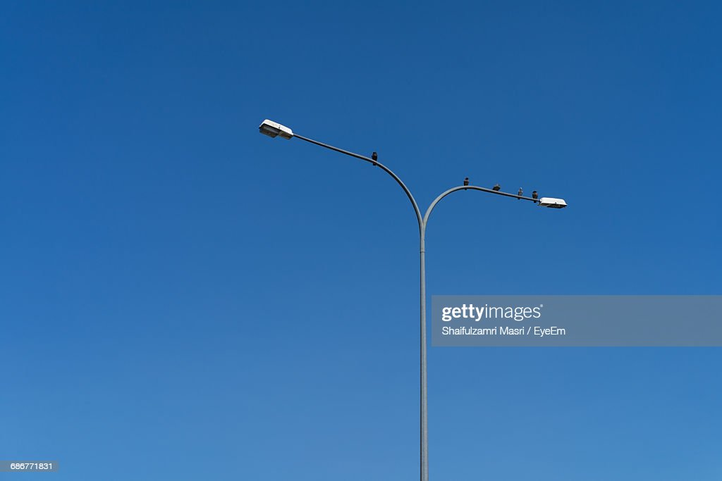 Low Angle View Of Street Light Against Clear Blue Sky : Stock Photo