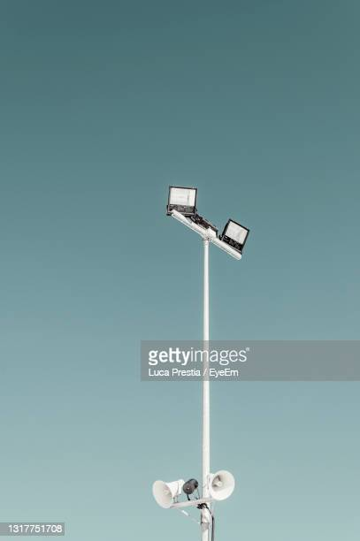 low angle view of street light against clear sky - クーネオ ストックフォトと画像