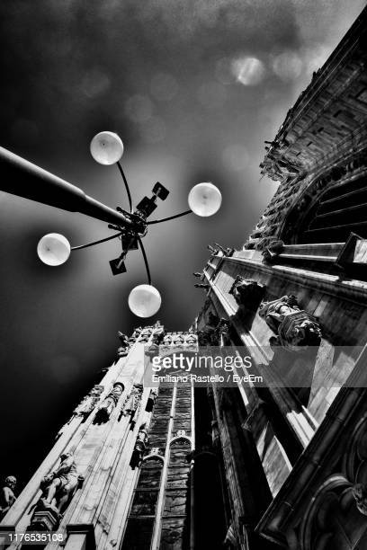 low angle view of street light against cloudy sky - emiliano rastello foto e immagini stock