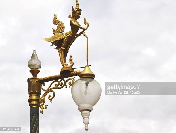 low angle view of street light against cloudy sky - van dijk stock pictures, royalty-free photos & images