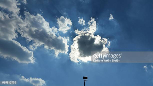 low angle view of street light against cloudy sky - weiß stock pictures, royalty-free photos & images