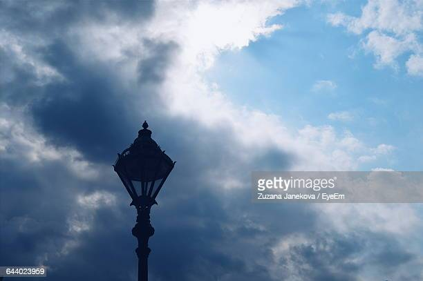 low angle view of street light against cloudy sky - zuzana janekova stock pictures, royalty-free photos & images