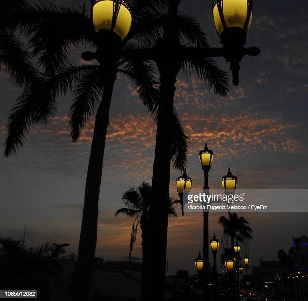 low angle view of street light against sky at sunset - oranjestad stockfoto's en -beelden