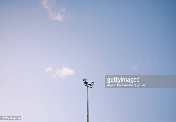 low angle view of street light against sky - day stock pictures, royalty-free photos & images