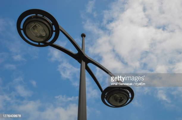 low angle view of street light against sky - treviso italy stock pictures, royalty-free photos & images