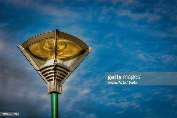 low angle view of street light against sky - andres ruffo stock pictures, royalty-free photos & images