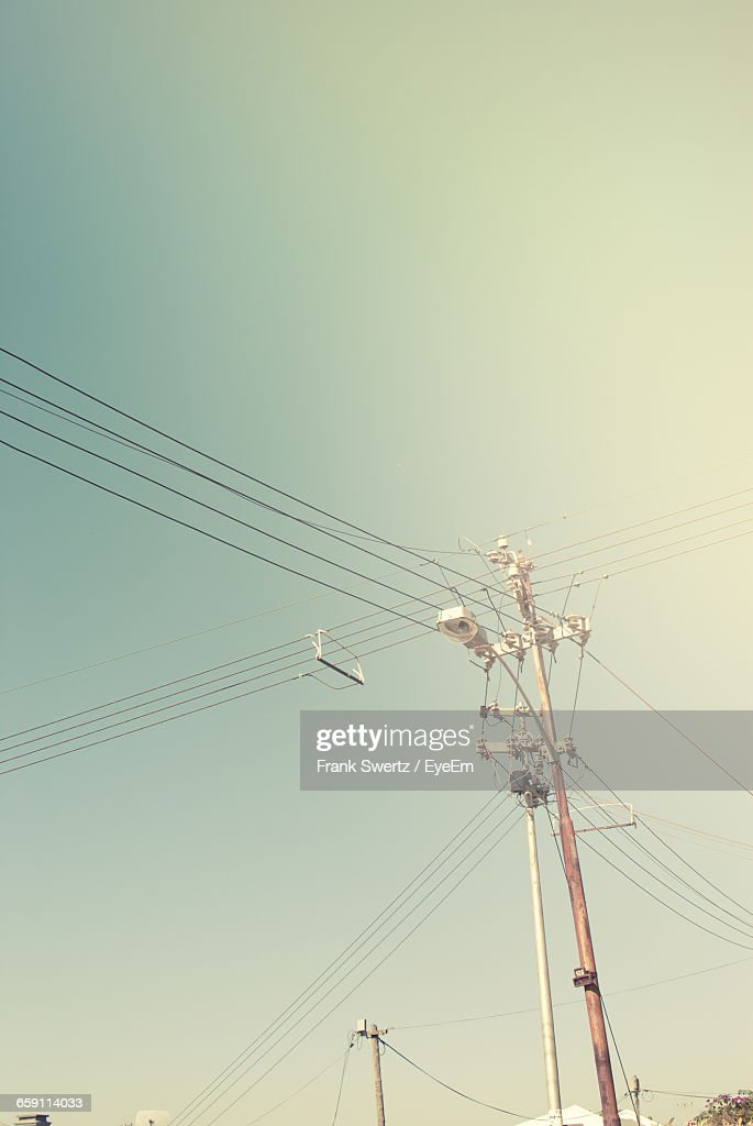 Low Angle View Of Street Light And Power Line Against Sky : Stock-Foto