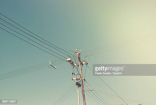 low angle view of street light and power line against sky - frank swertz stock pictures, royalty-free photos & images
