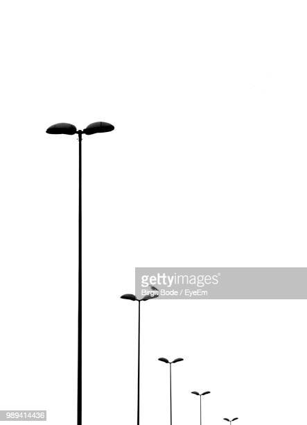 Low Angle View Of Street Lights Against Clear Sky